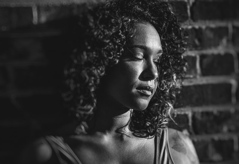 artist photography, headshot of woman with curly hair