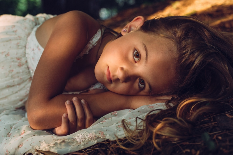 Children and Senior Photography, close up of little girl laying on the ground