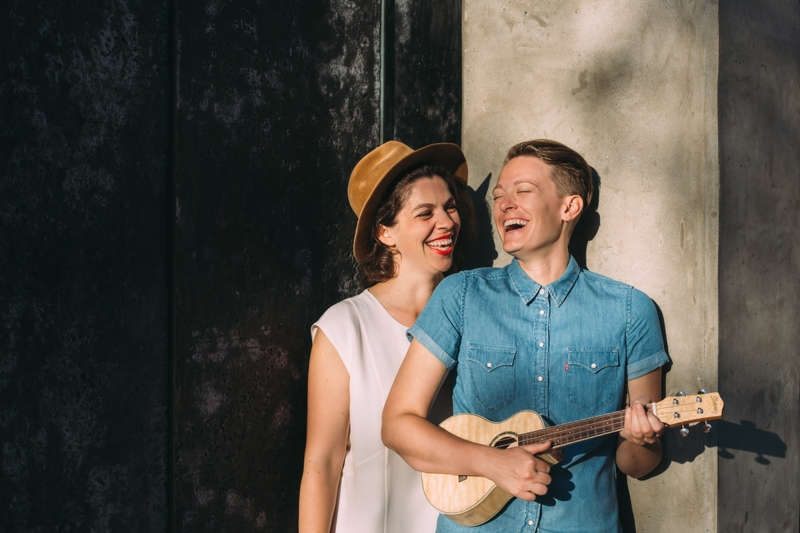 artist photography, women laughing together, one playing a ukulele