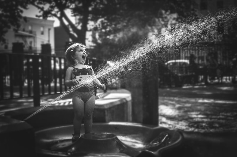 Children and Senior Photography, little girl playing with a hose