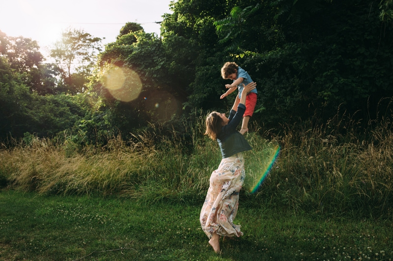 family photography, mother throwing son into the air