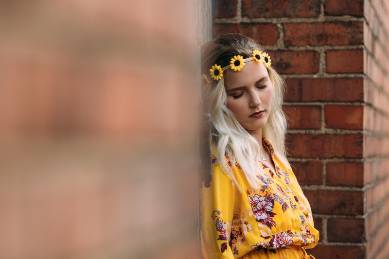 Children and Senior Photography, senior girl leaning against a door with a flower headband