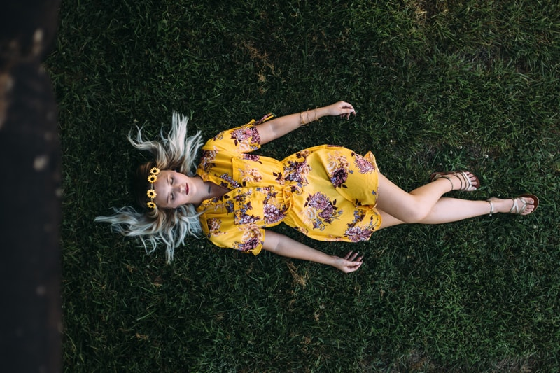 Children and Senior Photography, senior girl laying in the grass with a flower headband