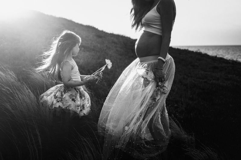 Motherhood and Maternity Photography, black and white of mother and daughter finding flowers