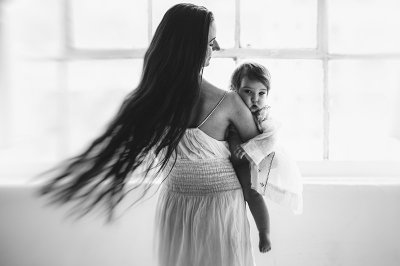 Motherhood and Maternity Photography, mother with long hair holding her baby
