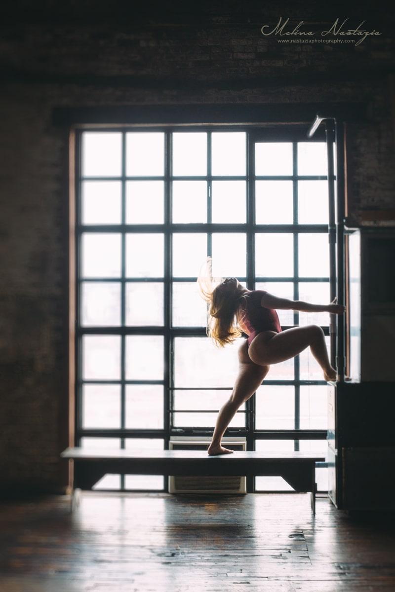 artist photography, dancer posing next to a window