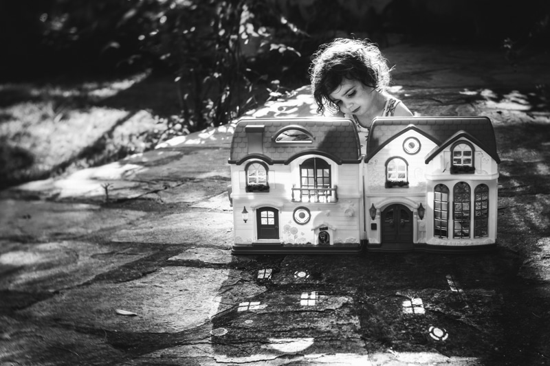 Children and Senior Photography, little girl playing with a toy house