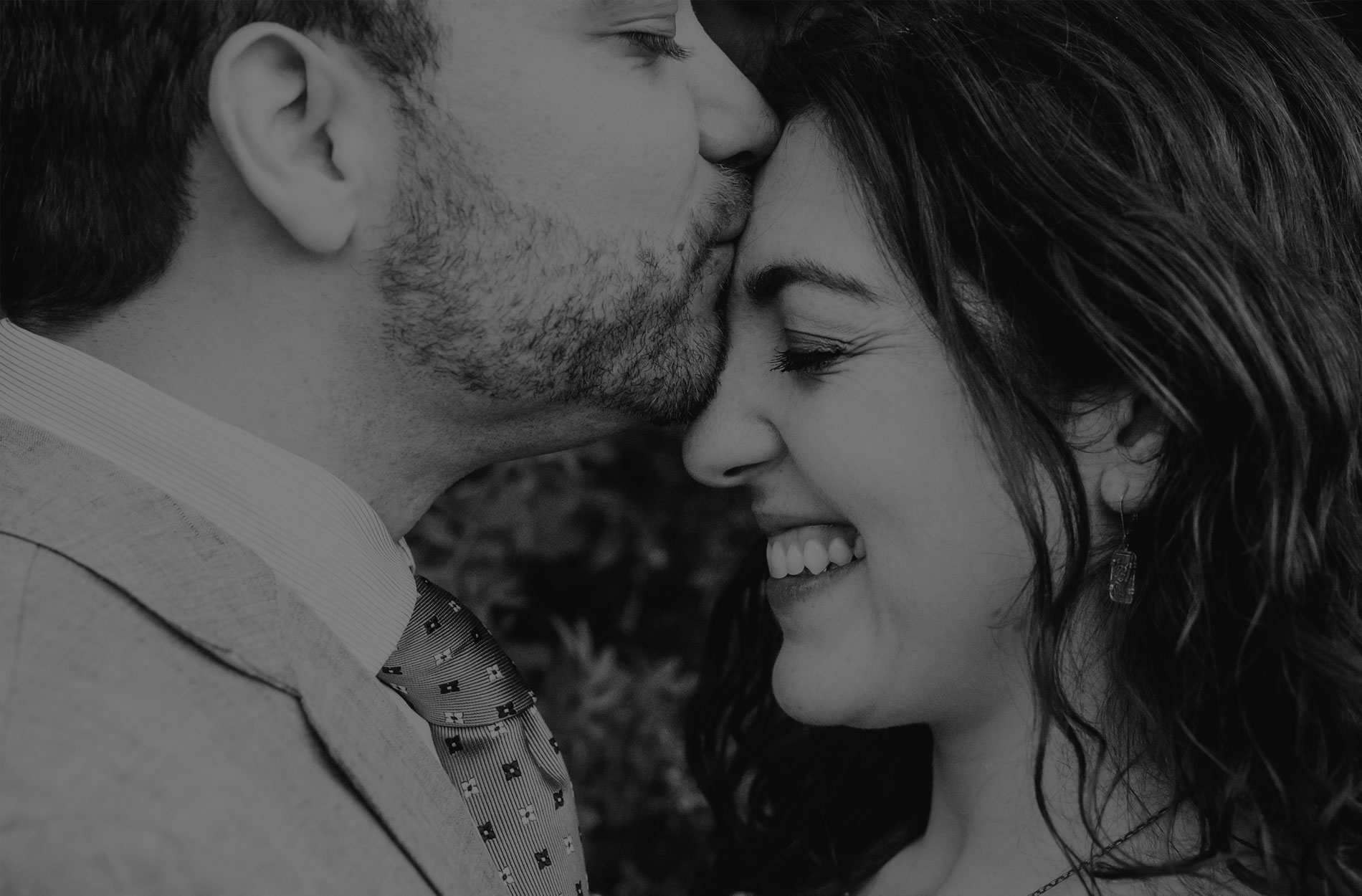 Couples photography, man kissing woman's forehead