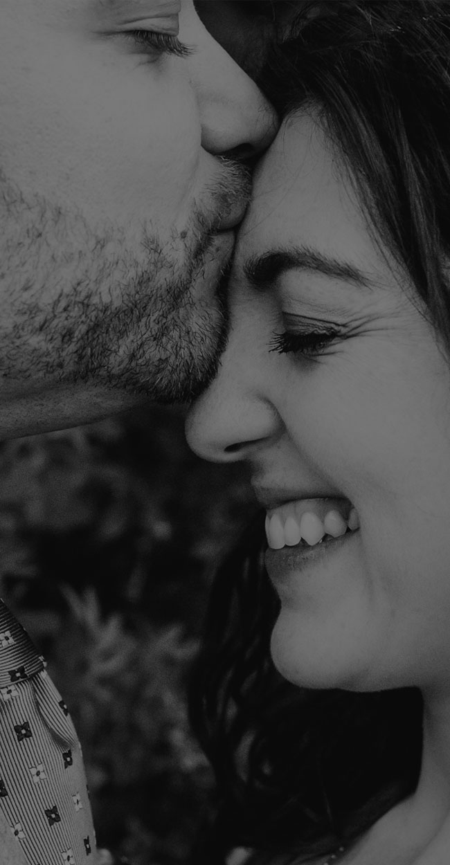 couples photography, man kissing the forehead of a smiling woman