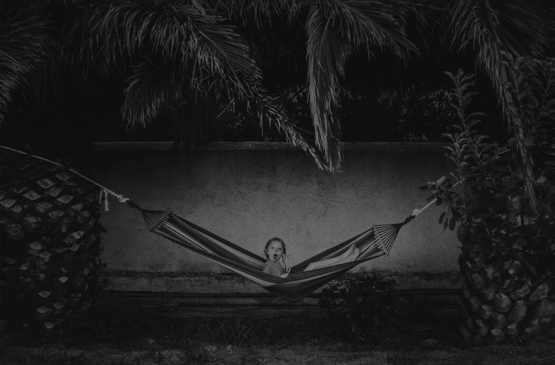 children photography, little child sitting up in a hammock
