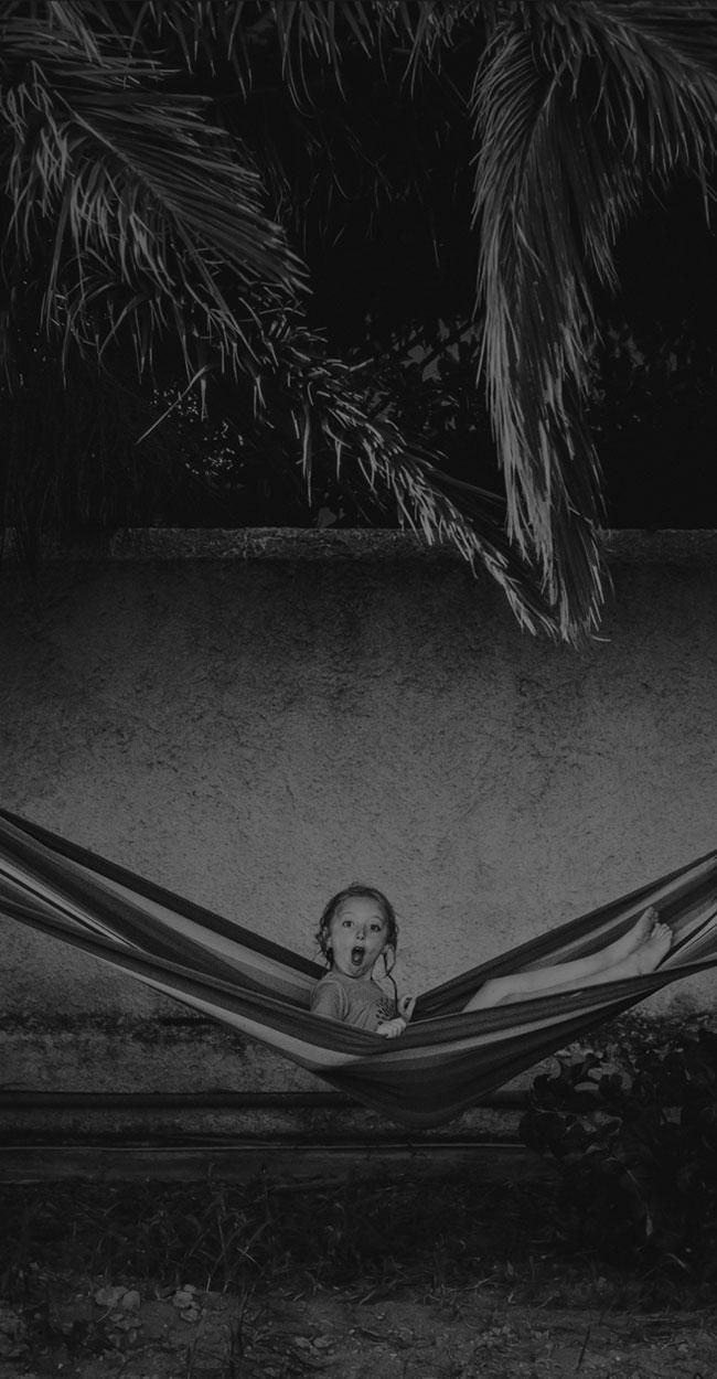 children photography, little girl sitting forward in a hammock