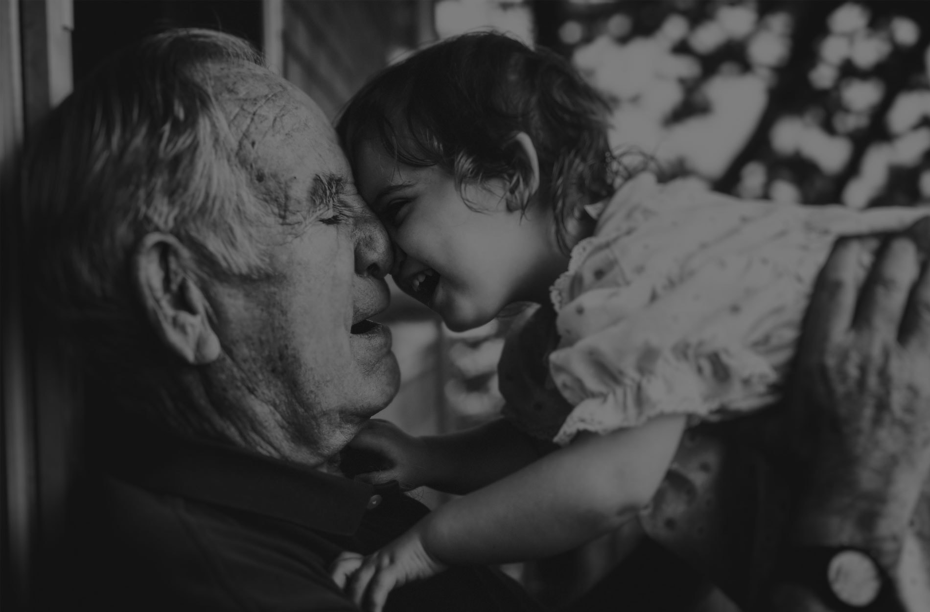 Family Photography, Grandpa holding up their grandchild to their face