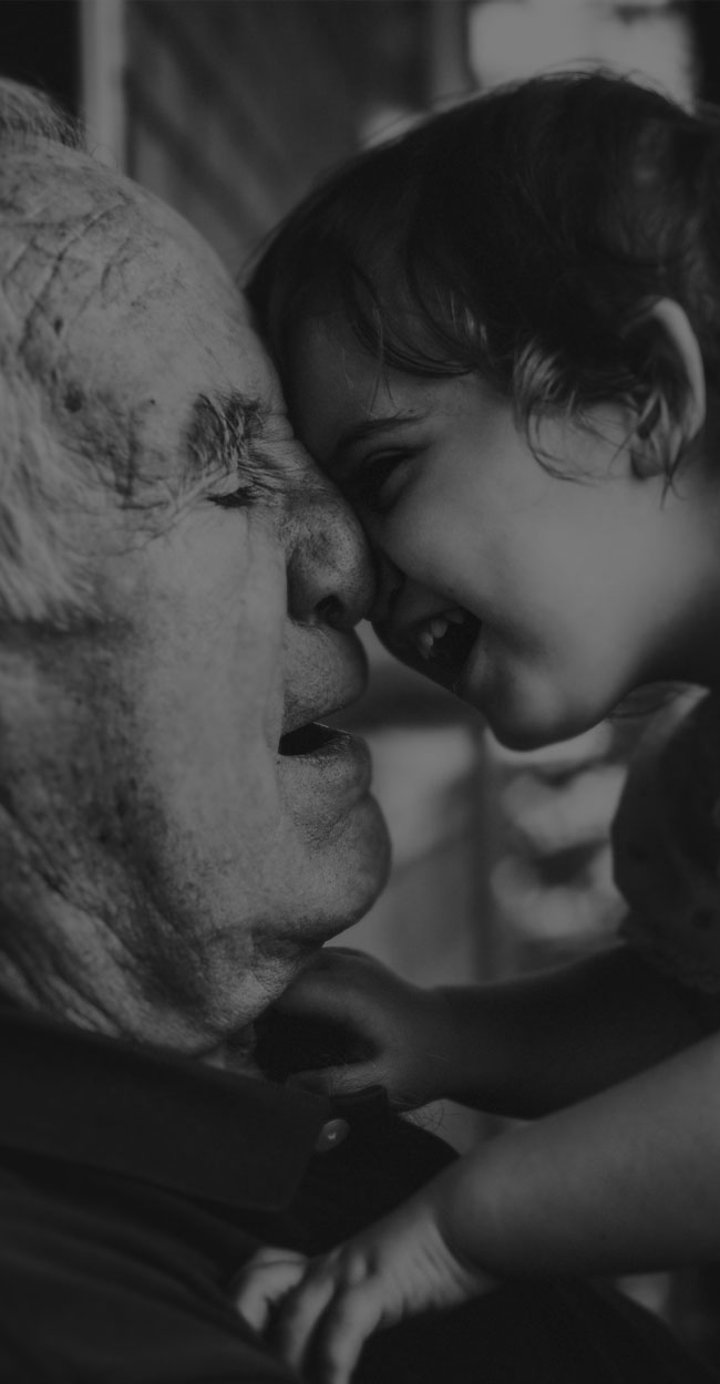 Family Photography, Grandfather touching foreheads with baby grandchild