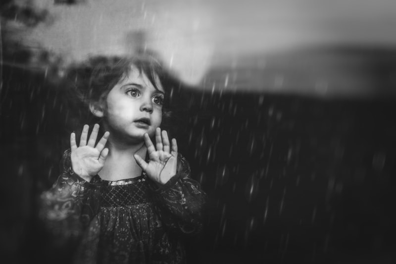 Children and Senior Photography, little girl looking out a rainy window