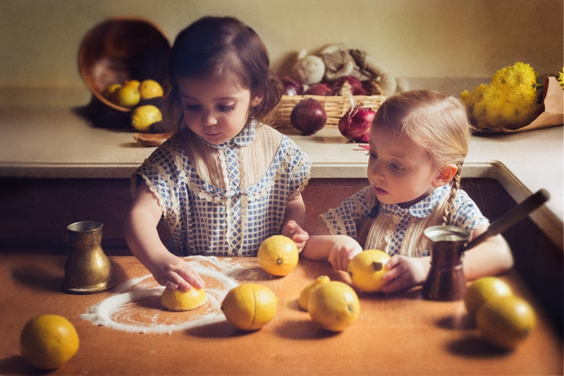 Children and Senior Photography, two little girls playing with lemons and sugar